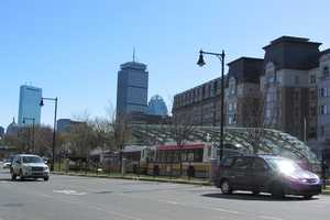 The Kenmore Square bus station with the Prudential and Hancock towers in the distance.