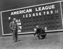 After the fire, the Sox installed a new scoreboard, seen here in 1935, along the center field wall.