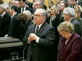 Menino prays at the funeral for former Boston Mayor Kevin White in 2012