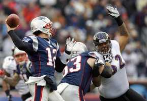 Tom Brady as Baltimore Ravens inside linebacker Ray Lewis closes in during the first half of the 2012 game.