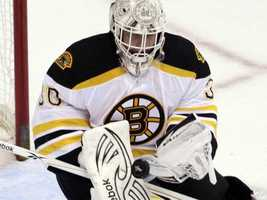 Boston Bruins goalie Tim Thomas (30) blocks a shot during the first period of an NHL hockey game against the Washington Capitals.