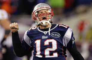 Tom Brady  celebrates after scoring a one yard touchdown during the second half during the 2012 game.