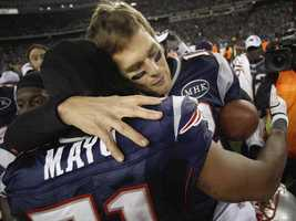 New England Patriots quarterback Tom Brady (12) hugs middle linebacker Jerod Mayo (51) after the AFC Championship game in Foxborough in 2012.