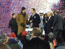 Honorary captain Drew Bledsoe holds the Lamar Hunt trophy in 2012.