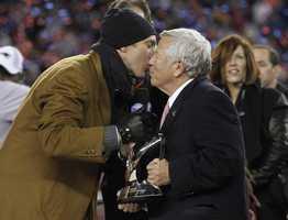 Former New England Patriots quarterback Drew Bledsoe, left, kisses New England Patriots owner Robert Kraftin 2012.