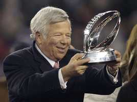 New England Patriots owner Robert Kraft holds up the championship trophy in 2012.