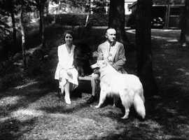 Calvin and Grace Coolidge with two of their dogs, including one of their white Collies, in 1930.