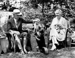Herbert and Lou Henry Hoover with their Elkhound, Weejie in 1932.