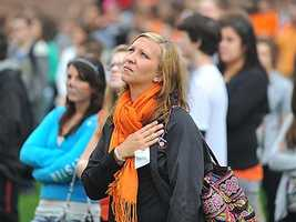 Theresa Caliri, a Taunton High School student, watches as the flag is raised to half staff at the 9/11 memorial service.