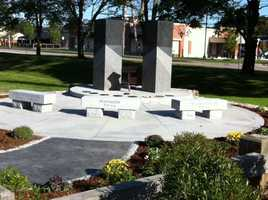 A granite and stone monument in Foxborough as a tribute to victims of 9/11, including resident Mike McGinty, who died in the World Trade Center.