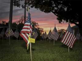 Members of the Braintree Sept 11 committee placed 3,000 American flags across the entire front lawn of Town Hall Plaza on the 10th anniversary of Sept. 11.