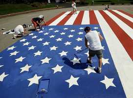 On the 10th anniversary, residents of the Alan Rd. cul-de-sac in Hudson repainted the 48 by 33 foot American flag that they created shortly after the terrorist attacks of Sept. 11, 2001.