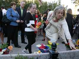 Family members pay their respects during ceremonies at a memorial to Massachusetts victims at the Boston Public Garden.