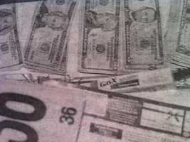 Prosecutors said Greig knew about this cash found in a drawer inside the apartment.