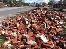 Bricks that once were buildings litter the tornadoes path