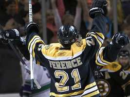 Andrew Ference reacts after scoring a goal.