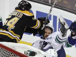Adam McQuaid knocks down a Vancouver player.