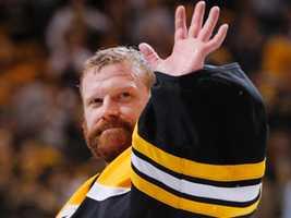 Tim Thomas waves to fans.