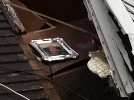 A photo is seen in the debris.