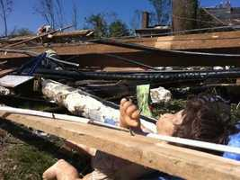 A child's doll is seen in the debris in Monson