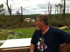 Norm Hammel looks at the damage to his home.