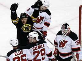 Boston Bruins right wing Shawn Thornton celebrates his goal, as he stands between New Jersey Devils' Patrik Elias (26), Anssi Salmela (29), Andy Greene (6) and goalie Martin Brodeur (30).