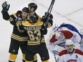Boston Bruins center Gregory Campbell, left, celebrates his goal with teammates Shawn Thornton, middle, and Brad Marchand (63) as Montreal Canadiens goalie Carey Price (31) and Canadiens center Tomas Plekanec (14), react.