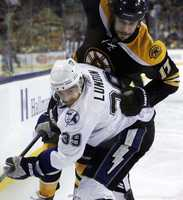 Left wing Milan Lucic tries to skate past Tampa Bay Lightning defenseman Mike Lundinduring the second period.