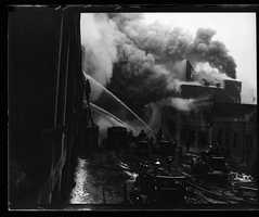 Crews battle a fire that broke out at Fenway in 1934.