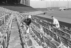 Workmen George Jansollwitz, left, and Tony Staskuna complete the job of installing 6,500 new comfortable seats at Fenway Park in Boston, March 20, 1961. Red Sox open their season against Kansas City at Fenway on April 11.