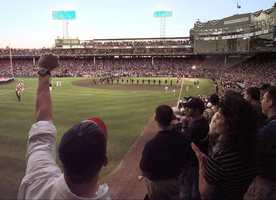 Fans in Fenway Park's leftfield seats cheer as the All Century baseball team is introduced before the start of Tuesday's All-Star Game, July 13, 1999 in Boston. The American League won the game 4-1.