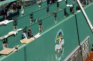 "Construction workers put together the finishing touches on the new seating area atop the ""Green Monster"" wall at Boston's Fenway Park, Thursday, April 10, 2003. Crews were rushing to have the legendary ballpark ready for Friday's Boston Red Sox home opener against the Baltimore Orioles."