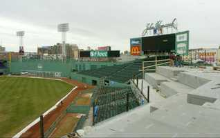 The foundation for new seating is being built, right, in the upper decks of right field at Boston's historic Fenway Park Thursday, March 11, 2004. The Boston Red Sox are adding new seats on the right field roof complete with table service, a full menu and some food/beverage offerings built into the price of a ticket.
