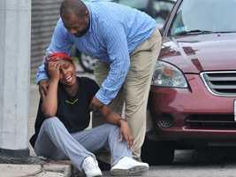 A woman is comforted at the scene in 2010.