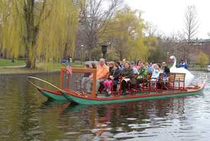 Menino is seen with his wife Angela riding a swan boat in the Boston Public Garden.
