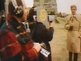 Reporter John Henning and crew