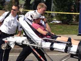 A runner being taken to Newton-Wellesley Hospital