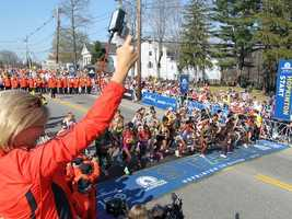 Allison Roe, the 1981 Boston Marathon women's champion, fires the starters pistol for the elite women's start of the 116th running of the Boston Marathon, in Hopkinton.