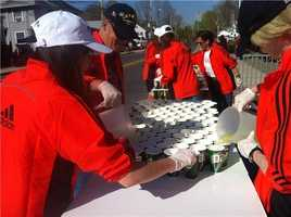 Getting cups with sports, energy drink ready along the course.