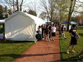 Runners arrived early in Hopkinton, preparing for what would be a very warm day. Some of the 27,000 registered runners opted to take up the organizers' offer to defer their entry until the 2013 race.