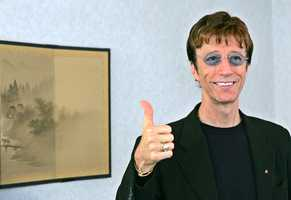 """Robin Gibb was one of three brothers who made up the disco group the Bee Gees behind """"Saturday Night Fever"""" and other hits from the 1970s. With their matching white suits, soaring high harmonies and polished, radio-friendly records, they remain one of the essential touchstones to that ultra-commercial era,"""" the Rock and Roll Hall of Fame says on its website. (22 December 1949 – 20 May 2012)"""