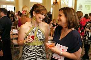 Kelley Tuthill talks with breast cancer survivor Lauren Foster.