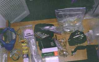 """In this photo released by the U.S. Attorney's office in Boston, shows an array of ammunition and handcuffs allegedly found in the Santa Monica, Calif. two-bedroom apartment where James """"Whitey"""" Bulger and Catherine Greig were arrested."""