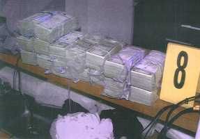 """This photo released by the U.S. Attorney's office, shows bundles of cash allegedly found in the Santa Monica, Calif. two-bedroom apartment where James """"Whitey"""" Bulger and Catherine Greig were arrested."""