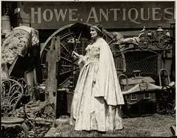 Mrs. Henry D. Tudor in charge of antique sales during Old Boston Day festivities on Beacon Hill, 1925.
