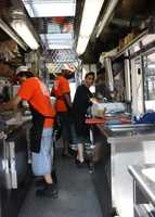It's hot in the back food truck kitchen, but the taco creators are up to the task