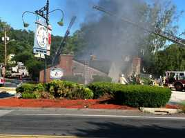 The Old Grist Mill Tavern caught fire after a truck overturned.