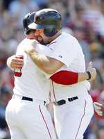 Youkilis gets a hug from Nick Punto.