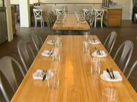 Communal dining tables are made from reclaimed bowling alleys.