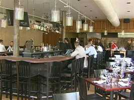 With Olive's facelift, the main focal point of the room is a large, rectangular bar.